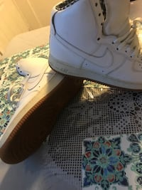 pair of white Nike Air Force 1's high