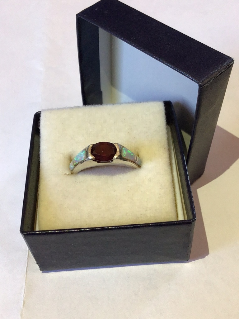Photo Sterling silver, opal and gem stone ring.