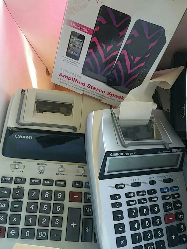 two white Canon printing calculators