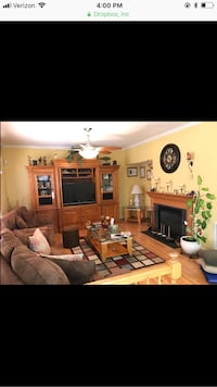 4 piece oak entertainment center and 2 glass top tables. 2 outer cabinets are glass encased and lighted.