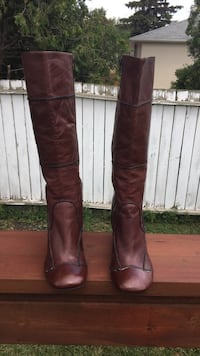 Pair of cherry red leather knee-high boots Winnipeg, R2J 2W3