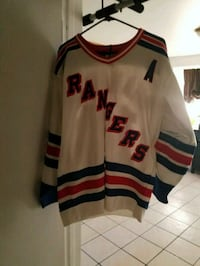 white, red, and blue ice hockey jersey