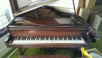 brown wooden framed upright piano Cleveland Heights, 44118