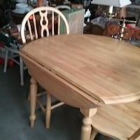 oval brown wooden dining table with chairs Rochester, 14606