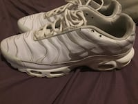 pair of white Nike running shoes New Orleans, 70126