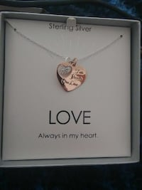 gold-colored heart pendant with silver-colored link necklace