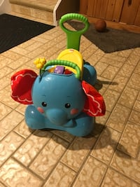toddler's multicolored Fisher-Price push ride-on toy