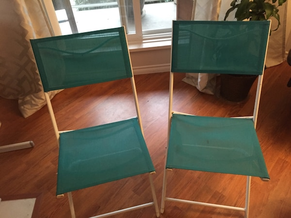 Two green outdoor chairs ff4dc151-5c10-4e4d-a6a2-fab0e72b2511