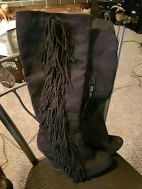 black suede knee-high wedge boots with fringe