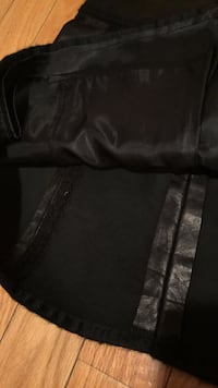 black leather skirt connected by inlays