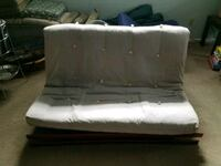 Grey fabric futon mattress,and wooden frame McLean