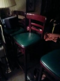 "Bar chairs. 30 1/2"" high. Solid wood very sturdy and nice. 75. For all"