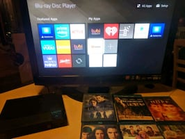 26in tv with Smart Sony Blu-Ray player & 6 movies