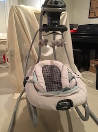 Baby's white and gray cradle n swing plays songs and relaxing sounds ( bits, rain, heart beat etc).