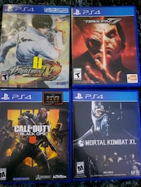 four assorted Sony PS4 game cases 26 km