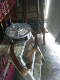 round clear glass top table with brown wooden base Las Vegas, 89110