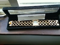 Gold and white diamond watch with box.  Rolla, 65401