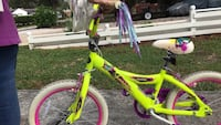toddler's yellow and pink bicycle 646 mi