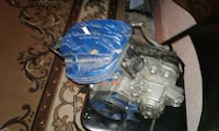 blue and gray mechanical machine part