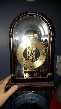 brown-framed clear glass mantle clock