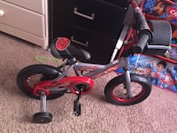 Toddler's black and red bicycle with training wheels Baltimore, 21206