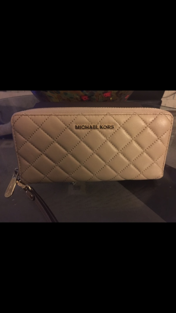 d539c16a8a82 Used Brand new Authentic Michael Kors Jet Set Large Travel Wallet Quilted  Leather - removable leather wrist band for sale in Richmond - letgo