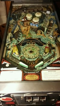 black, green, and white pinball machine Savannah, 64485