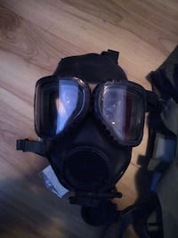 Military grade gas masks with original bag asking 80 dollars for one