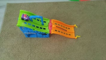 yellow, blue, and red plastic toy