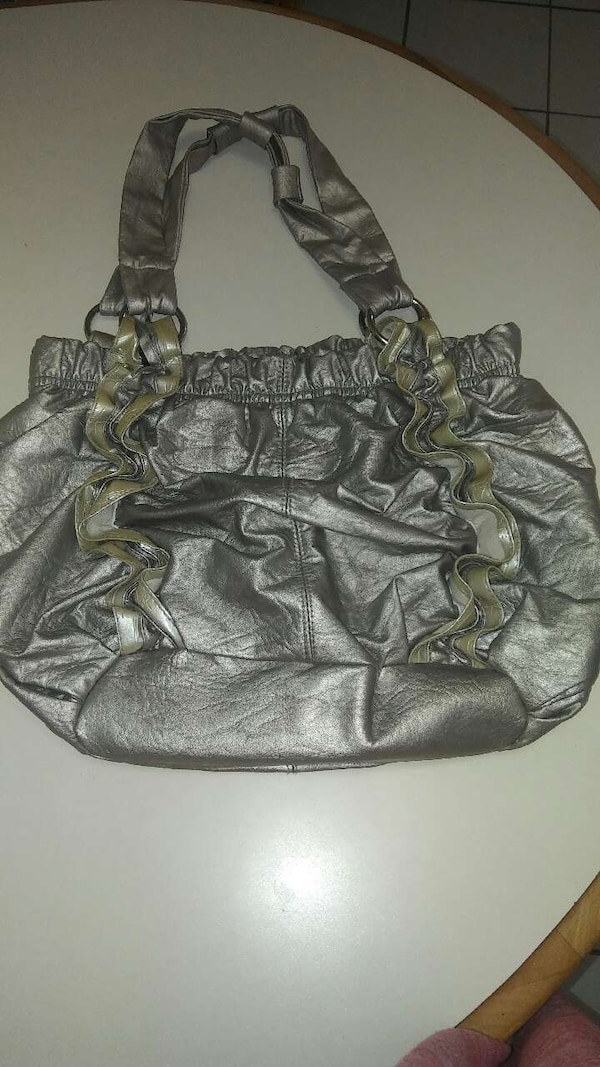 5513869180f4 Used Grayish pink metallic purse for sale in Park Forest - letgo