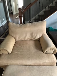 Overstuffed couch with matching chair and ottoman