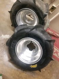 ITP aftermarket rims and tires for 4 wheelers or ATV and like new