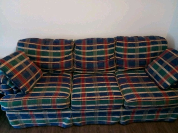 red, blue, and green plaid fabric sofa