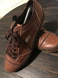 Pair of brown lacoste leather low-top sneaker