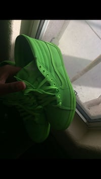 pair of green Nike low-top sneakers 2052 mi