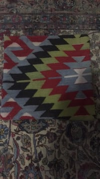 white, red, and black area rug 42 km