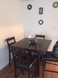 Wood table and 4 chairs a value of $575