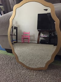 brown wooden framed wall mirror 30 km
