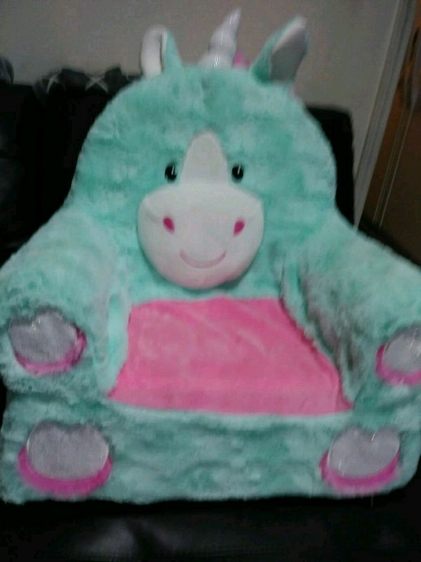 green and pink bear plush toy