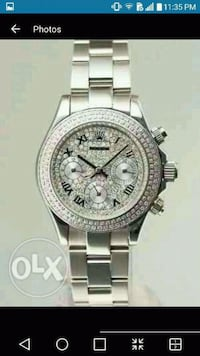 round silver chronograph watch with silver link bracelet Longueuil, J4V 1A9