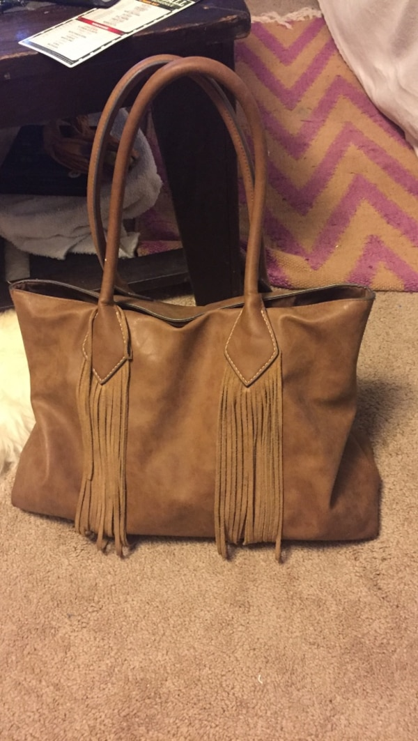 0bc0458ccdc96e Used Brown leather fringe tote bag for sale in Cottage Grove - letgo