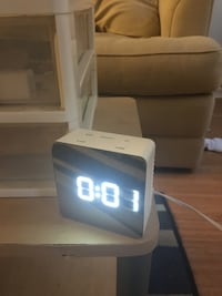 Need to wake up? Brand new alarm clock for sale!