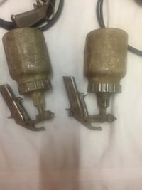 two brown metal spray cans