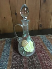 clear glass pitcher with glass