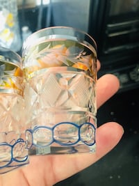 Two bohemian crystal cut coloured shot glasses