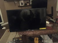 black flat screen TV with remote Leduc, T9E 6Z7