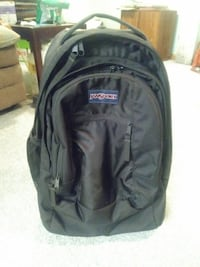 black and gray Jansport backpack