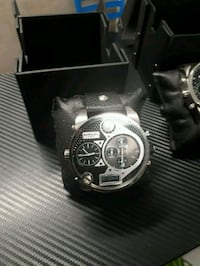 round silver-colored chronograph watch with black  Montréal, H3C 3Z7