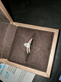 silver-colored clear gemstone encrusted ring with case