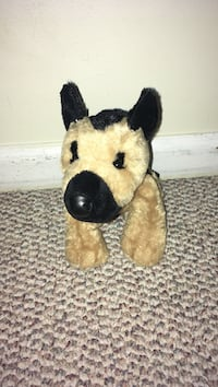 black and brown dog plush toy